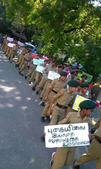 Awareness slogan placards held up by students
