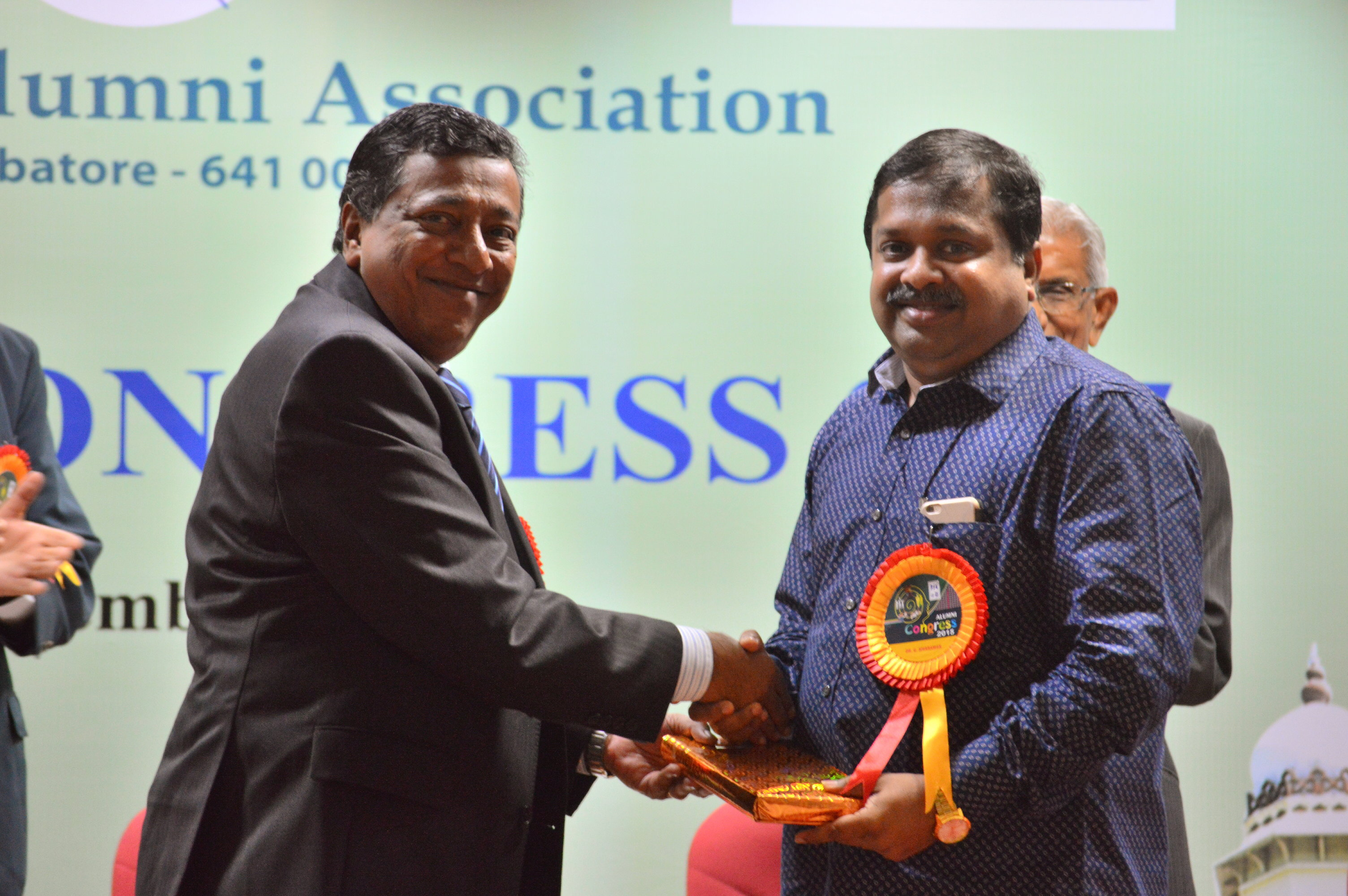 The guest of honour, Dr. Sivaraman receiving a memento
