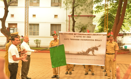 The Principal flagging off the rally